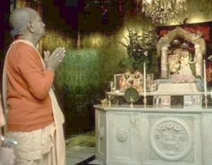 Srila Prabhupada takes darshan of Sri Vrindaban Nath at the original New Vrindaban farmhouse, 1976.