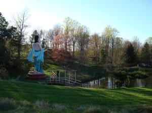 Large Gaura Nitai Statues Glance over the lake at New Vrindaban.