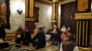 An attentive crowd inside Prabhupada's Palace.