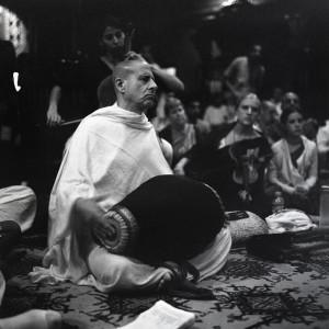 Radhanath Maharaj playing mridanga at 24 hour kirtan 2013