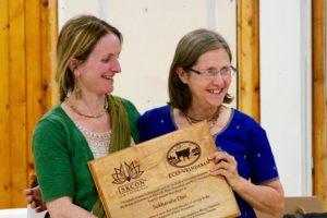 Ananga Manjari presents Sukhavaha dasi her service appreciation plaque. New Vrindaban ISKCON Brijabasi
